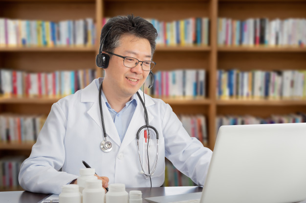 asian-doctor-who-is-remotely-consulting-with-patient-telehealth-concept_127345-10
